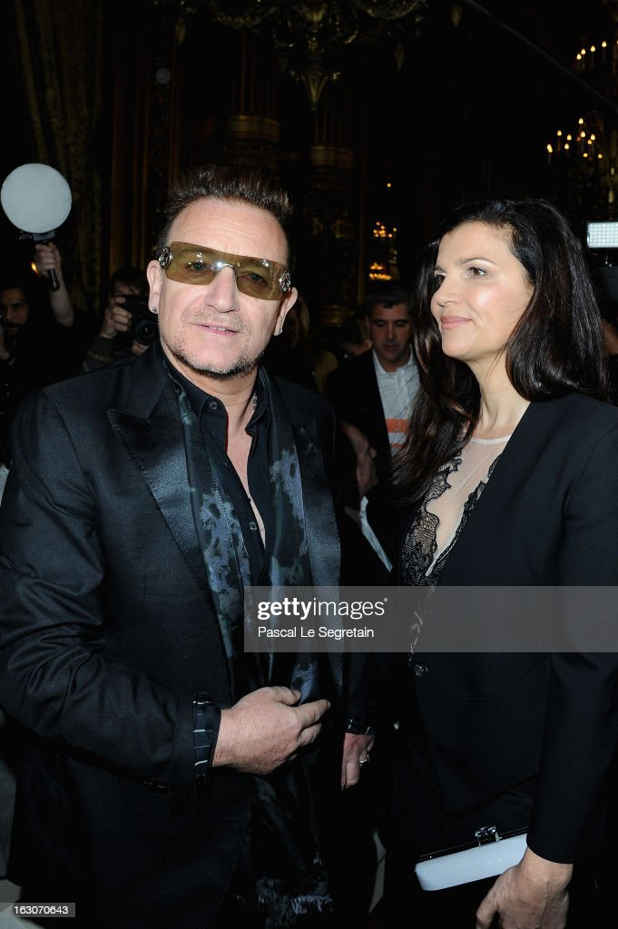 <a gi-track='captionPersonalityLinkClicked' href=/galleries/search?phrase=Bono+-+Singer&family=editorial&specificpeople=167279 ng-click='$event.stopPropagation()'>Bono</a> and his wife <a gi-track='captionPersonalityLinkClicked' href=/galleries/search?phrase=Ali+Hewson&family=editorial&specificpeople=210576 ng-click='$event.stopPropagation()'>Ali Hewson</a> attend the Stella McCartney Fall/Winter 2013 Ready-to-Wear show as part of Paris Fashion Week on March 4, 2013 in Paris, France.