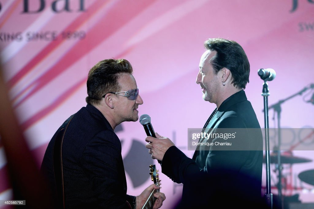 <a gi-track='captionPersonalityLinkClicked' href=/galleries/search?phrase=Bono+-+Singer&family=editorial&specificpeople=167279 ng-click='$event.stopPropagation()'>Bono</a> and <a gi-track='captionPersonalityLinkClicked' href=/galleries/search?phrase=Julian+Lennon&family=editorial&specificpeople=211480 ng-click='$event.stopPropagation()'>Julian Lennon</a> perform on stage during the Leonardo Dicaprio Foundation Launch at Domaine Bertaud Belieu on July 23, 2014 in Saint-Tropez, France.