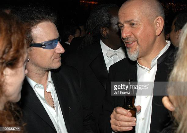 Bono and Peter Gabriel during Miramax 2003 Golden Globes Party Sponsored by Glamour Magazine and Coors at Trader Vic's in Beverly Hills CA United...