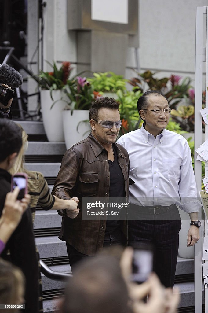 Bono and President of the World Bank Jim Yong Kim arrive at the World Bank on November 14, 2012 in Washington, DC.