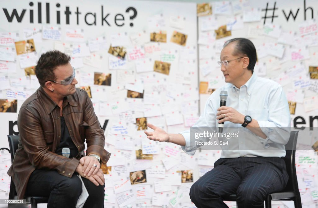 Bono and President of the World Bank Jim Yong Kim speaks at the World Bank on November 14 2012 in Washington DC