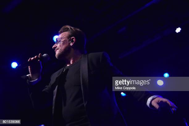 Bono and U2 perform on stage at the 13th Annual MusiCares MAP Fund Benefit Concert at the PlayStation Theater on June 26 2017 in New York City...
