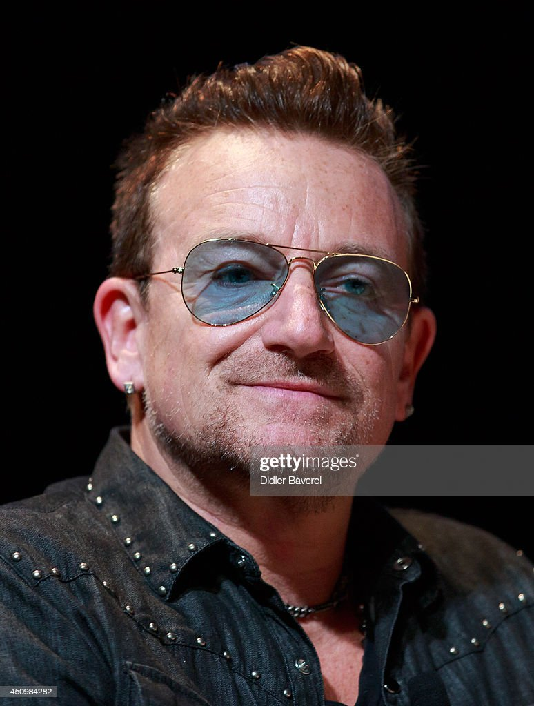 Bono arrives for a conversation with Jonathan Ive at the 2014 Cannes Lions on June 21 2014 in Cannes France