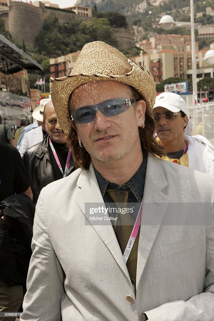 <a gi-track='captionPersonalityLinkClicked' href=/galleries/search?phrase=Bono+-+Singer&family=editorial&specificpeople=167279 ng-click='$event.stopPropagation()'>Bono</a> arrives in the paddock at the Formula One Monaco Grand Prix on May 23, 2004 in Monte Carlo, Monaco.