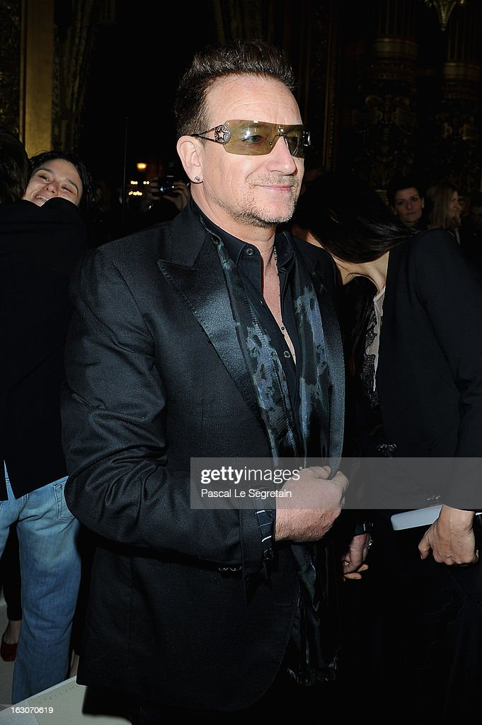 <a gi-track='captionPersonalityLinkClicked' href=/galleries/search?phrase=Bono+-+Singer&family=editorial&specificpeople=167279 ng-click='$event.stopPropagation()'>Bono</a> attends the Stella McCartney Fall/Winter 2013 Ready-to-Wear show as part of Paris Fashion Week on March 4, 2013 in Paris, France.