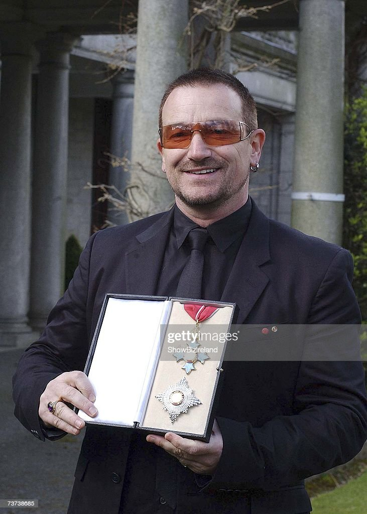 Bono, birth name Paul Hewson, poses after receiving a Knighthood from Ambassador David Reddaway awarded to him by Her Majesty the Queen in recognition of his services to the music industry and his humanitarian work, at the British Ambassador's residence on March 29, 2007 in Dublin, Ireland.
