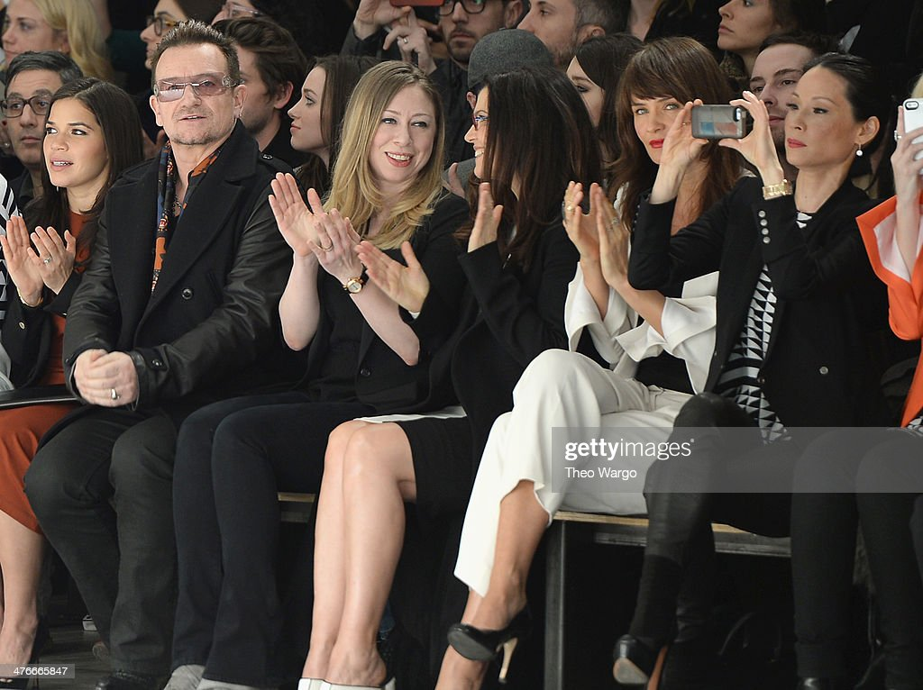 <a gi-track='captionPersonalityLinkClicked' href=/galleries/search?phrase=Bono+-+Singer&family=editorial&specificpeople=167279 ng-click='$event.stopPropagation()'>Bono</a>, <a gi-track='captionPersonalityLinkClicked' href=/galleries/search?phrase=Chelsea+Clinton&family=editorial&specificpeople=119698 ng-click='$event.stopPropagation()'>Chelsea Clinton</a>, <a gi-track='captionPersonalityLinkClicked' href=/galleries/search?phrase=Helena+Christensen&family=editorial&specificpeople=202841 ng-click='$event.stopPropagation()'>Helena Christensen</a> and Lucy Lui attend the Edun fashion show during Mercedes-Benz Fashion Week Fall 2014 at Skylight Modern on February 9, 2014 in New York City.