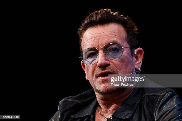 Bono joins Dana Brunetti Eric Wahlforss and David Cart in a discussion on the Web Summit Centre Stage at the 2014 Web Summit on November 6 2014 in...