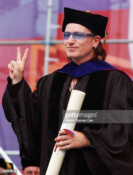 Bono lead singer and songwriter for the rock group U2 and a socialjustice activist gives a peace sign after he receives an honorary Doctor of Laws...