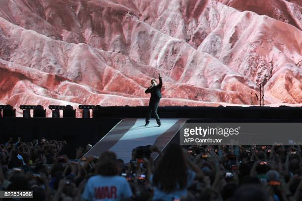 TOPSHOT Bono lead singer of Irish rock band U2 performs on stage at the Stade de France in SaintDenis outside Paris on July 25 2017 / AFP PHOTO /...