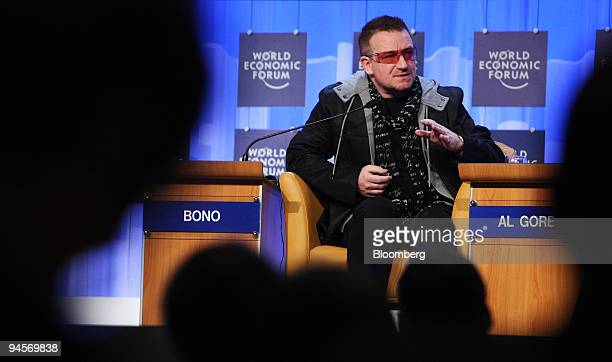 Bono lead singer of Irish rock group U2 and cofounder of Debt AIDS Trade Africa speaks during a session entitled 'Combining Solutions to Extreme...