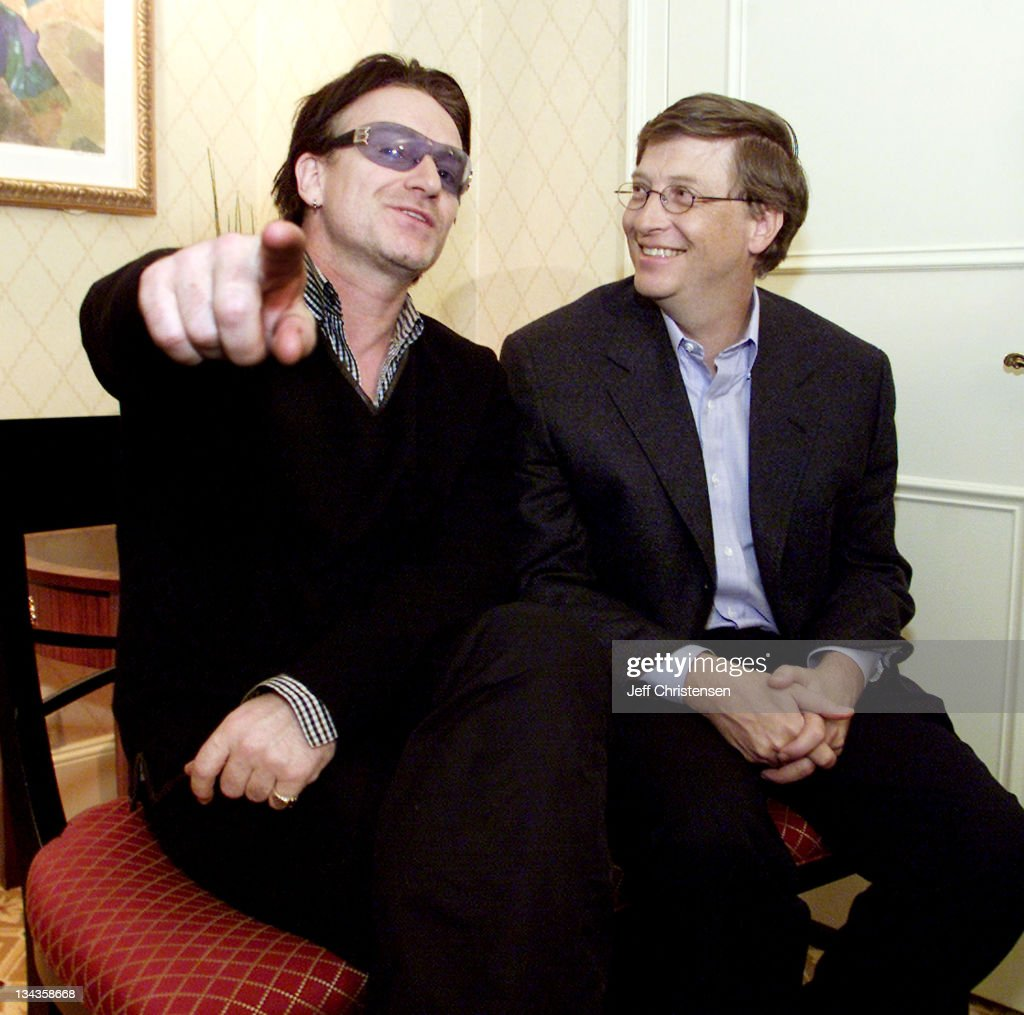 <a gi-track='captionPersonalityLinkClicked' href=/galleries/search?phrase=Bono&family=editorial&specificpeople=167279 ng-click='$event.stopPropagation()'>Bono</a> (L), lead singer of the rock group <a gi-track='captionPersonalityLinkClicked' href=/galleries/search?phrase=U2&family=editorial&specificpeople=201268 ng-click='$event.stopPropagation()'>U2</a>, and Microsoft chairman <a gi-track='captionPersonalityLinkClicked' href=/galleries/search?phrase=Bill+Gates&family=editorial&specificpeople=202049 ng-click='$event.stopPropagation()'>Bill Gates</a> sit together before a news conference at the World Economic Forum in New York, February 2, 2002. Gates teamed up with rock icon <a gi-track='captionPersonalityLinkClicked' href=/galleries/search?phrase=Bono&family=editorial&specificpeople=167279 ng-click='$event.stopPropagation()'>Bono</a> in an appeal to world leaders to substantially increase funding for global health care.