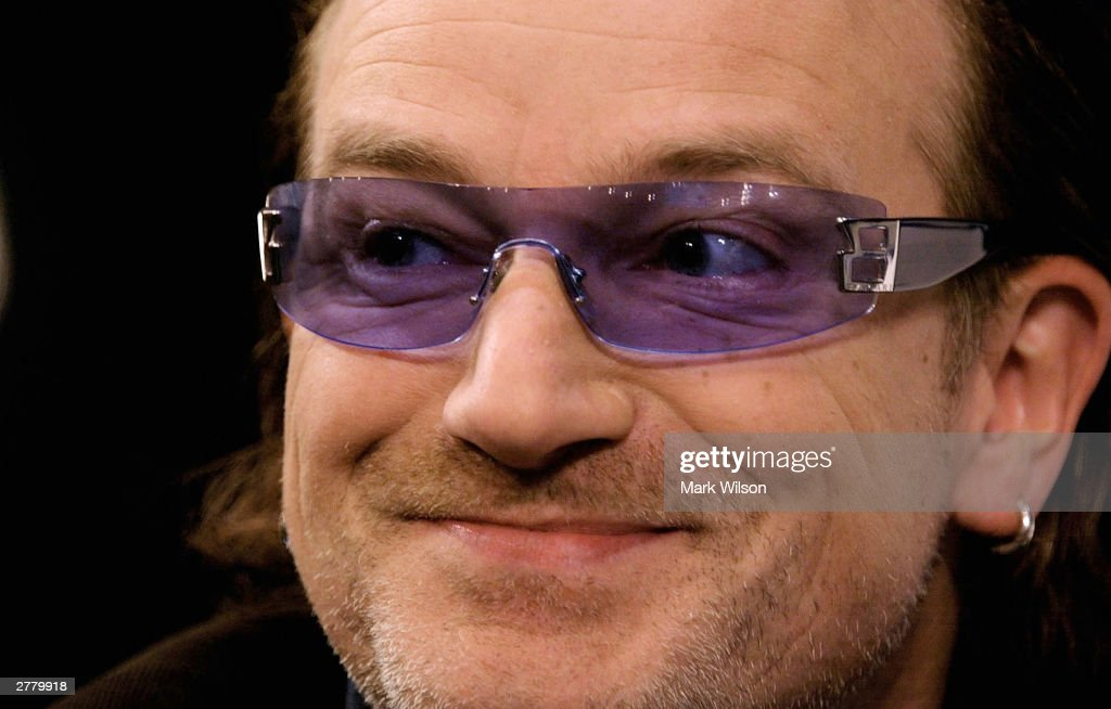 <a gi-track='captionPersonalityLinkClicked' href=/galleries/search?phrase=Bono+-+Singer&family=editorial&specificpeople=167279 ng-click='$event.stopPropagation()'>Bono</a>, lead singer of the rock group U2, speaks about AIDs December 3, 2003 in Washington, DC. The Kaiser Foundation hosted a seminar on the U.S. and global committment to HIV/AIDS and Africa.