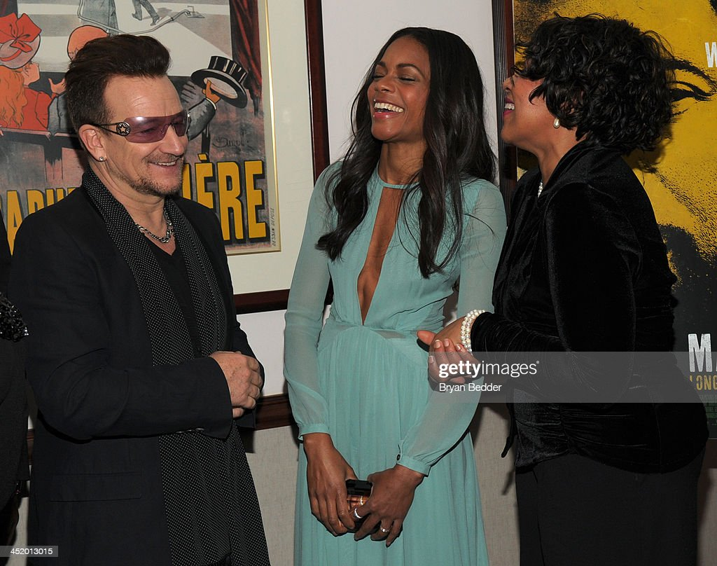 <a gi-track='captionPersonalityLinkClicked' href=/galleries/search?phrase=Bono+-+Singer&family=editorial&specificpeople=167279 ng-click='$event.stopPropagation()'>Bono</a>, <a gi-track='captionPersonalityLinkClicked' href=/galleries/search?phrase=Naomie+Harris&family=editorial&specificpeople=238918 ng-click='$event.stopPropagation()'>Naomie Harris</a> and Zenani Mandela attend U2 And Anna Wintour Host A Special Screening Of Mandela: Long Walk To Freedom, In Partnership With Burberry And The New York Times at Ziegfeld Theatre on November 25, 2013 in New York City.