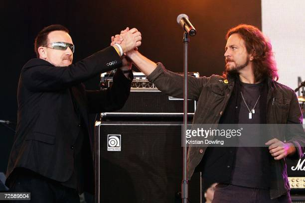 Bono of 'U2' and Eddie Vedder of 'Pearl Jam' appear on stage together after performing at the Make Poverty History concert at the Sidney Myer Music...