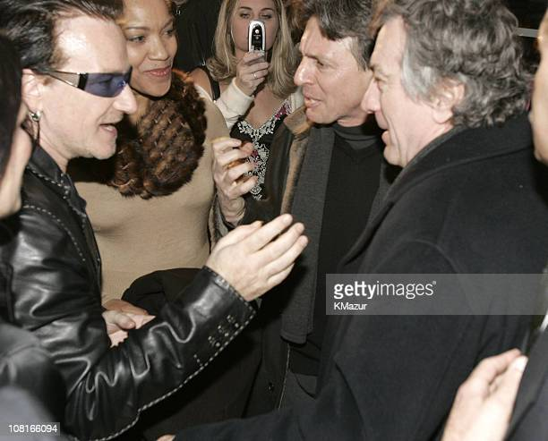 Bono of U2 and Robert De Niro during Saks Fifth Avenue and Bono Host Launch of EDUN March 11 2005 at Saks Fifth Ave in New York City New York United...