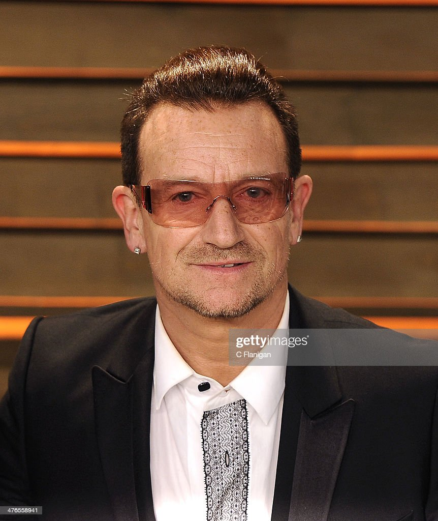<a gi-track='captionPersonalityLinkClicked' href=/galleries/search?phrase=Bono&family=editorial&specificpeople=167279 ng-click='$event.stopPropagation()'>Bono</a> of U2 arrives at the 2014 Vanity Fair Oscar Party Hosted By Graydon Carter on March 2, 2014 in West Hollywood, California.