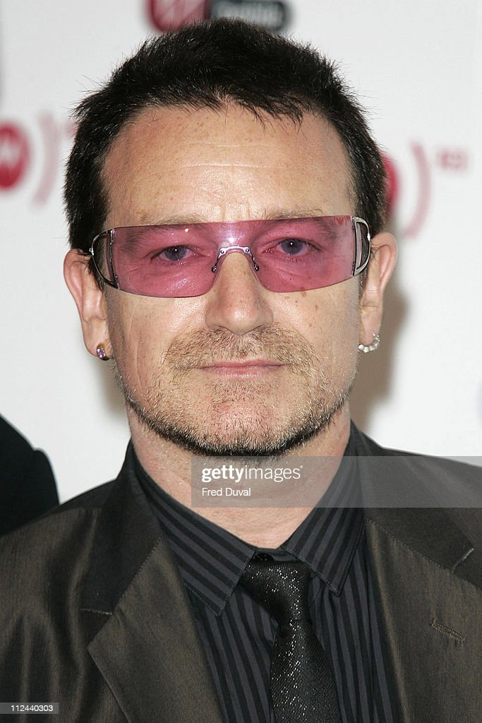 <a gi-track='captionPersonalityLinkClicked' href=/galleries/search?phrase=Bono&family=editorial&specificpeople=167279 ng-click='$event.stopPropagation()'>Bono</a> of <a gi-track='captionPersonalityLinkClicked' href=/galleries/search?phrase=U2&family=editorial&specificpeople=201268 ng-click='$event.stopPropagation()'>U2</a> during <a gi-track='captionPersonalityLinkClicked' href=/galleries/search?phrase=Bono&family=editorial&specificpeople=167279 ng-click='$event.stopPropagation()'>Bono</a> Announces the Latest Iconic Brand (RED) to Join Product - May 15, 2006 at Carphone Warehouse, Oxford Street in London, United Kingdom.