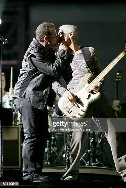 Bono of U2 give a kiss to Adam Clayton during the 360 Tour at Palais Nikaia Stade Charles Ehrmann on July 15 2009 in Nice France
