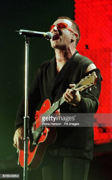 Bono of U2 in concert at Wembley Stadium