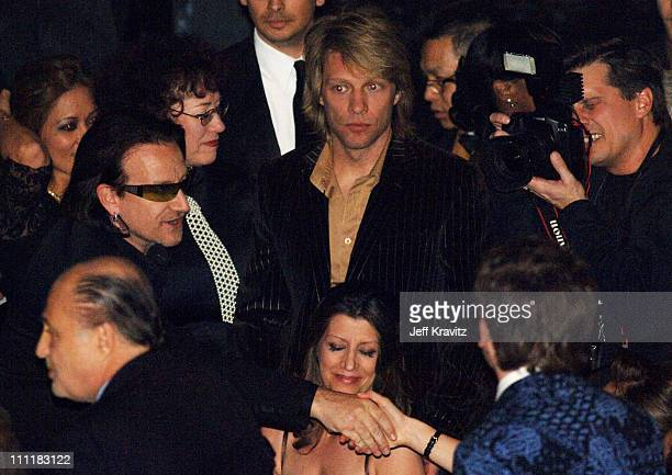 Bono of U2 inductee with Jon Bon Jovi and Kevin Mazur