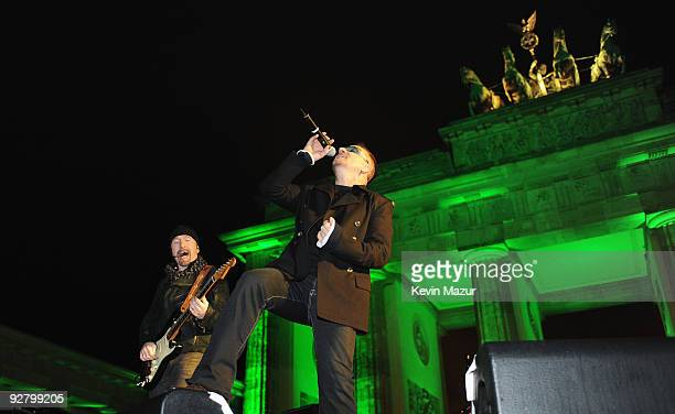 Bono of U2 performs during a concert in front of the Brandenburg Gate the on November 5 2009 in Berlin Germany U2 performed a free concert in...