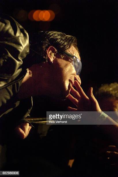 Bono of U2 performs on stage at Gelredome Arnhem Netherlands 31st July 2001