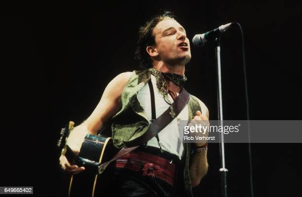 Bono of U2 performs on stage on The Joshua Tree Tour at Feyenoord Stadion De Kuip Rotterdam Netherlands 10th July 1987