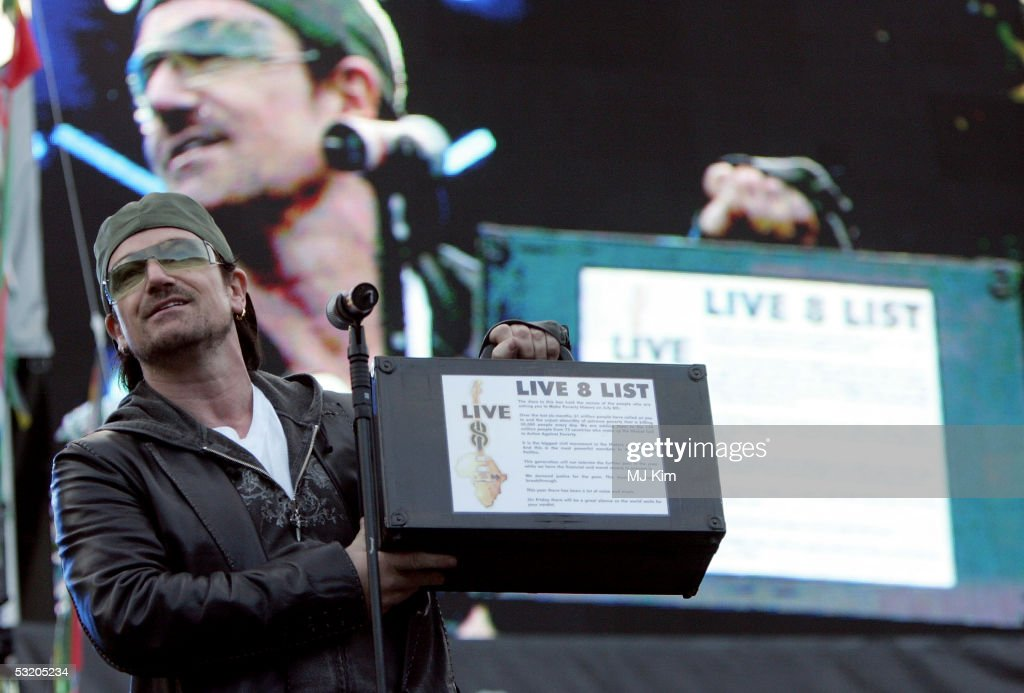 Bono performs on stage at the Live 8 Edinburgh concert at Murrayfield Stadium on July 6, 2005 in Edinburgh, Scotland. The free gig, labelled Edinburgh 50,000 - The Final Push, is organised by Midge Ure, alongside Geldof, and coincides with the G8 summit to raisie awareness for MAKEpovertyHISTORY.