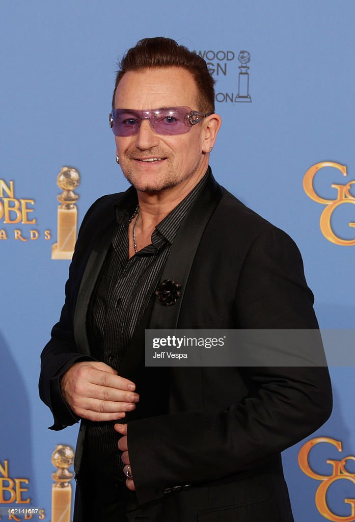Bono poses in the press room during the 71st Annual Golden Globe Awards held at The Beverly Hilton Hotel on January 12 2014 in Beverly Hills...