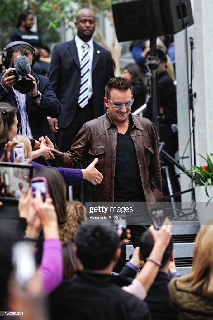 <a gi-track='captionPersonalityLinkClicked' href=/galleries/search?phrase=Bono&family=editorial&specificpeople=167279 ng-click='$event.stopPropagation()'>Bono</a> shakes hands with audience members upon arriving at the World Bank on November 14, 2012 in Washington, DC.