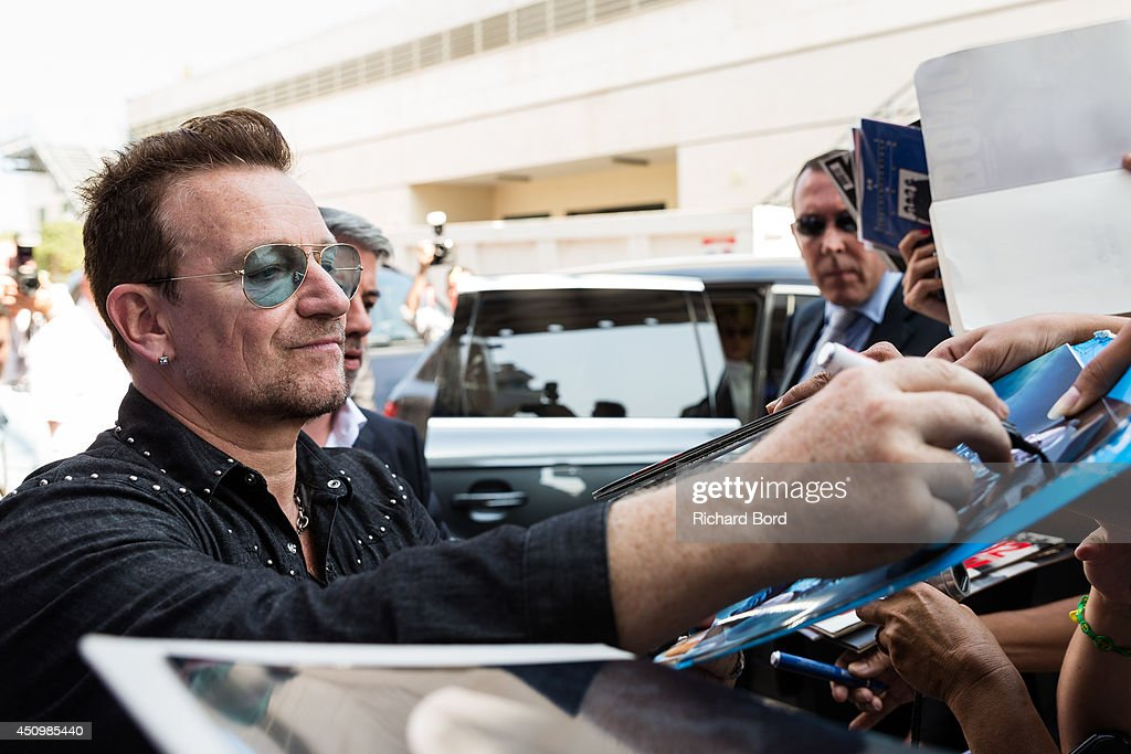 Bono signs autographs for fans after the 'Bono and Jonathan Ive Seminar' during the 2014 Cannes Lions Festival on June 21, 2014 in Cannes, France.