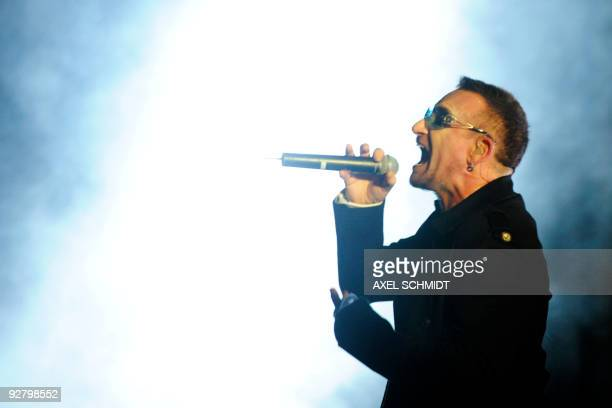 Bono singer of the Irish rock band U2 performs on stage at the Brandenburg Gate in Berlin during a free openair concert on November 5 2009 as part of...