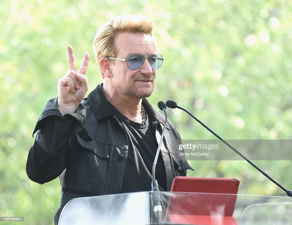 Bono speaks at Amnesty International Tapestry Honoring John Lennon Unveiling at Ellis Island on July 29, 2015 in New York City.