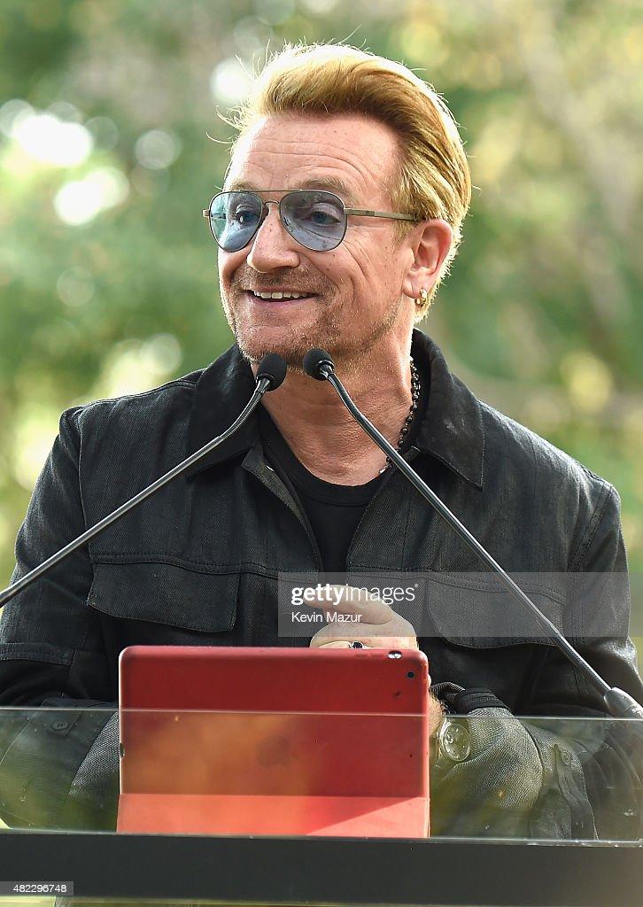 Bono speaks at Amnesty International Tapestry Honoring John Lennon Unveiling at Ellis Island on July 29, 2015 in New York City.