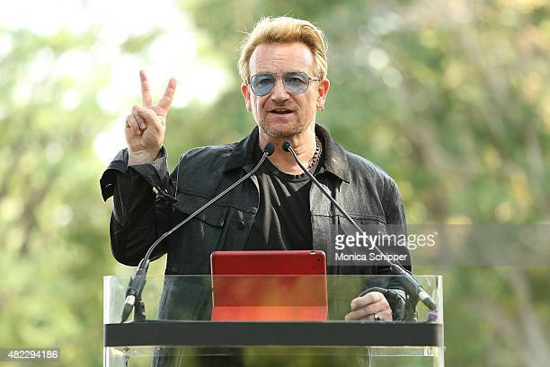 Bono speaks at the Amnesty International Tapestry Honoring John Lennon Unveiling at Ellis Island on July 29 2015 in New York City