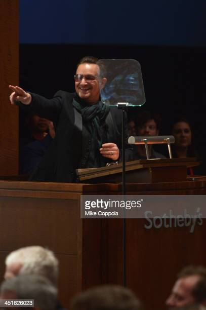 Bono speaks onstage during Jony And Marc's Auction at Sotheby's on November 23 2013 in New York City Photo by Mike Coppola/Getty Images for