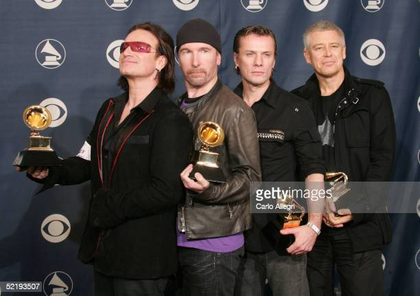 Bono The Edge Larry Mullen and Adam Clayton of the band U2 pose with their award for 'Best Rock Performance by a Group' backstage during the 47th...