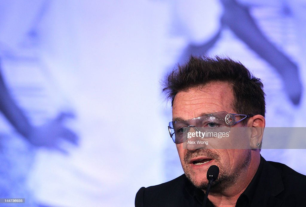 <a gi-track='captionPersonalityLinkClicked' href=/galleries/search?phrase=Bono+-+Singer&family=editorial&specificpeople=167279 ng-click='$event.stopPropagation()'>Bono</a>, U2 lead singer and cofounder of ONE, speaks during the Symposium on Global Agriculture and Food Security May 18, 2012 at the Ronald Reagan Building in Washington, DC. The symposium, hosted by the Chicago Council on Global Affairs, in collaboration with the World Economic Forum, was to discuss new activities to advance global agricultural development, food and nutrition security in Africa.
