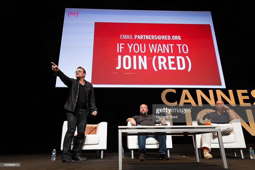 Bono, Vice Media CEO Shane Smith and Apple's Senior Vice President of Design Sir Jonathan Ive attend the 'Bono and Jonathan Ive Seminar' during the 2014 Cannes Lions Festival on June 21, 2014 in Cannes, France.