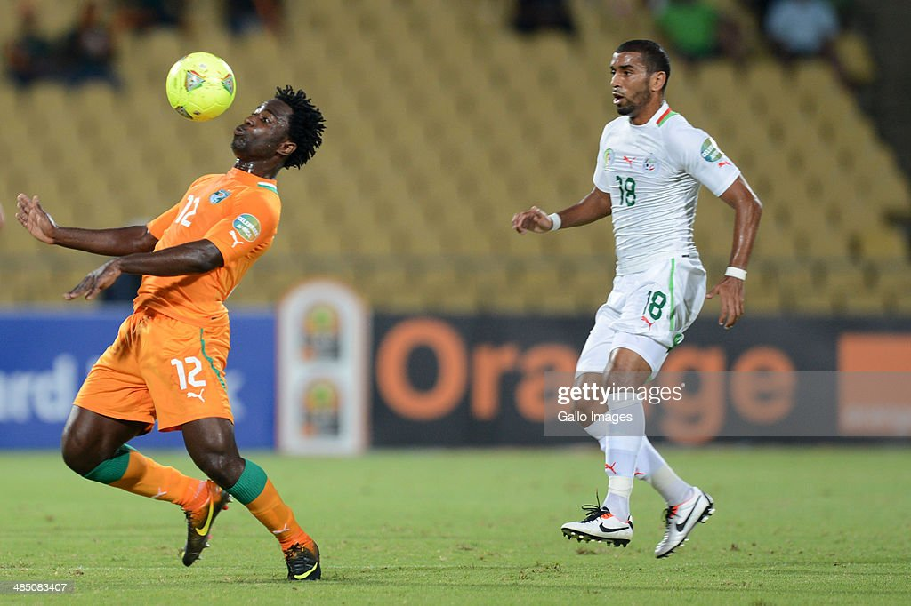 Bony Wilfried of Ivory Coast and Kaled Lemmouchia of Algeria (R) during the 2013 African Cup of Nations match between Algeria and Ivory Coast at Royal Bafokeng Stadium on January 30, 2013 in Rustenburg, South Africa.
