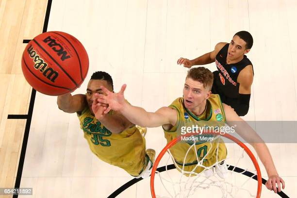 Bonzie Colson and Rex Pflueger of the Notre Dame Fighting Irish look for the rebound against the Princeton Tigers during the first round of the 2017...