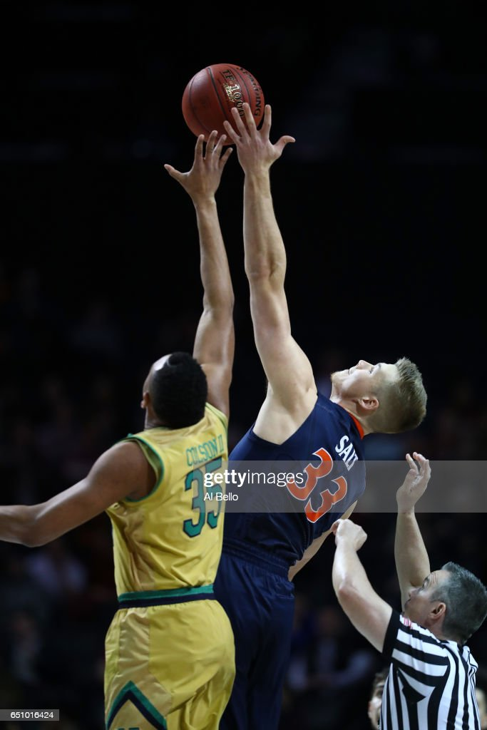 Bonzie Colson #35 of the Notre Dame Fighting Irish against the Notre Dame Fighting Irish Jack Salt #33 of the Virginia Cavaliers start the game during the Quarterfinals of the ACC Basketball Tournament at the Barclays Center on March 9, 2017 in New York City.