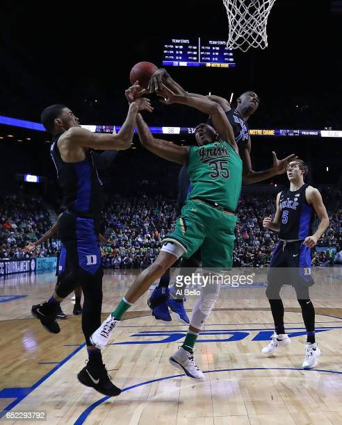 Bonzie Colson of the Notre Dame Fighting Irish battles against Jayson Tatum and Harry Giles of the Duke Blue Devils during the championship game of...