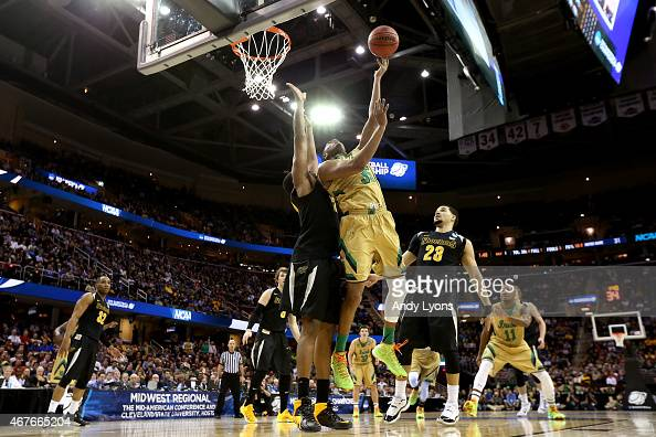 Bonzie Colson of the Notre Dame Fighting Irish drives to the basket against Darius Carter of the Wichita State Shockers in the first half during the...