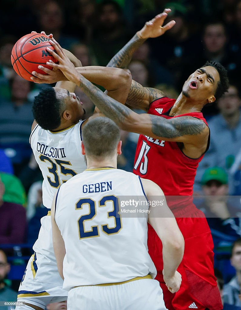 Bonzie Colson #35 of the Notre Dame Fighting Irish goes up for the shot as Ray Spalding #13 of the Louisville Cardinals defends for the at Purcell Pavilion on January 4, 2017 in South Bend, Indiana.
