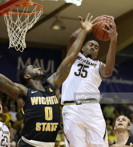 Bonzie Colson of the Notre Dame Fighting Irish hauls in a rebound over Rashard Kelly of the Wichita State Shockers during the second half at the Maui...