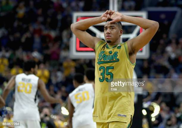 Bonzie Colson of the Notre Dame Fighting Irish reacts after being defeated by the West Virginia Mountaineers 8371 during the second round of the 2017...