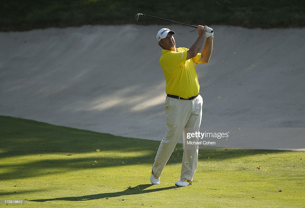 <a gi-track='captionPersonalityLinkClicked' href=/galleries/search?phrase=Boo+Weekley&family=editorial&specificpeople=3486615 ng-click='$event.stopPropagation()'>Boo Weekley</a> hits a shot from the fairway during the first round of the John Deere Classic held at TPC Deere Run on July 11, 2013 in Silvis, Illinois.