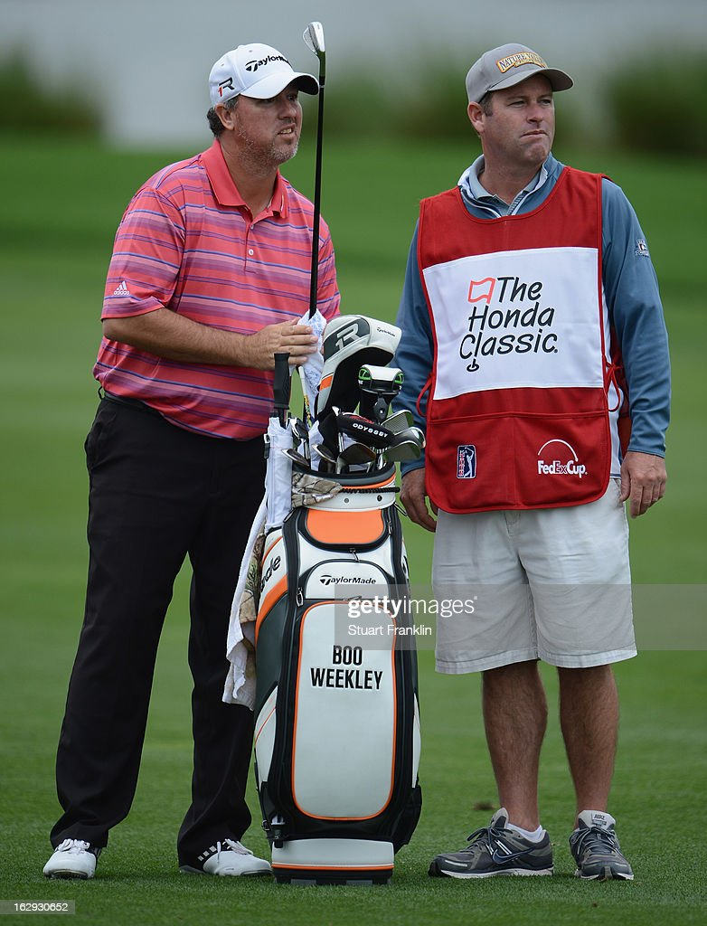 Boo Weekley of USA and caddie ponder a shot on the nineth hole during the second round of the Honda Classic on March 1, 2013 in Palm Beach Gardens, Florida.